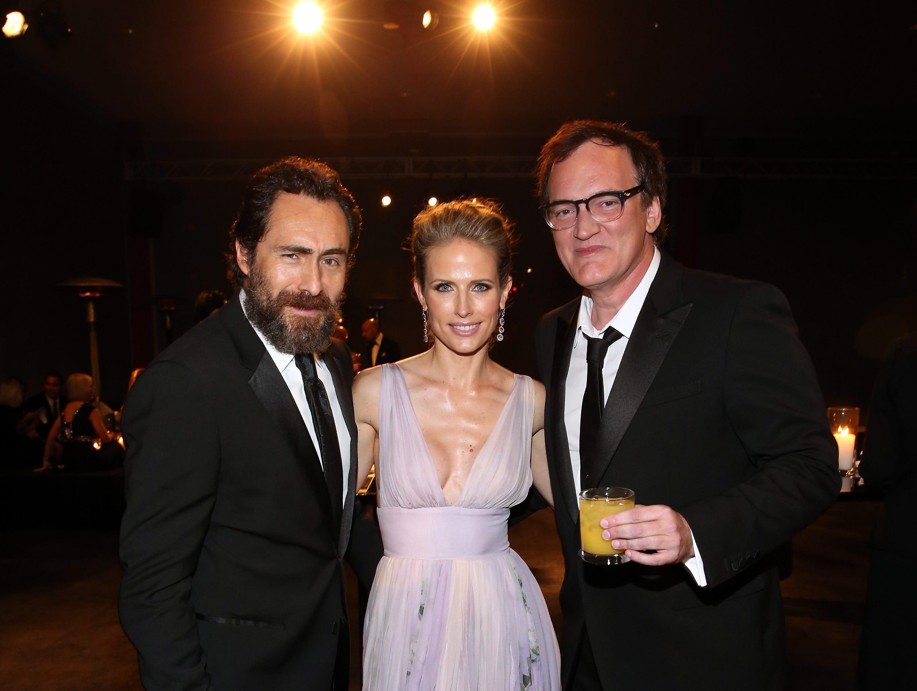 Demian Bichir and Quentin Tarantino flank Stefanie Sherk at the 2014 LACMA Art + Film Gala on Nov. 1, 2014, in Los Angeles.
