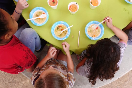 """Fourth-grade students taste chicken soup during a """"Chef in the Garden"""" lesson at Echo Canyon School in Scottsdale."""