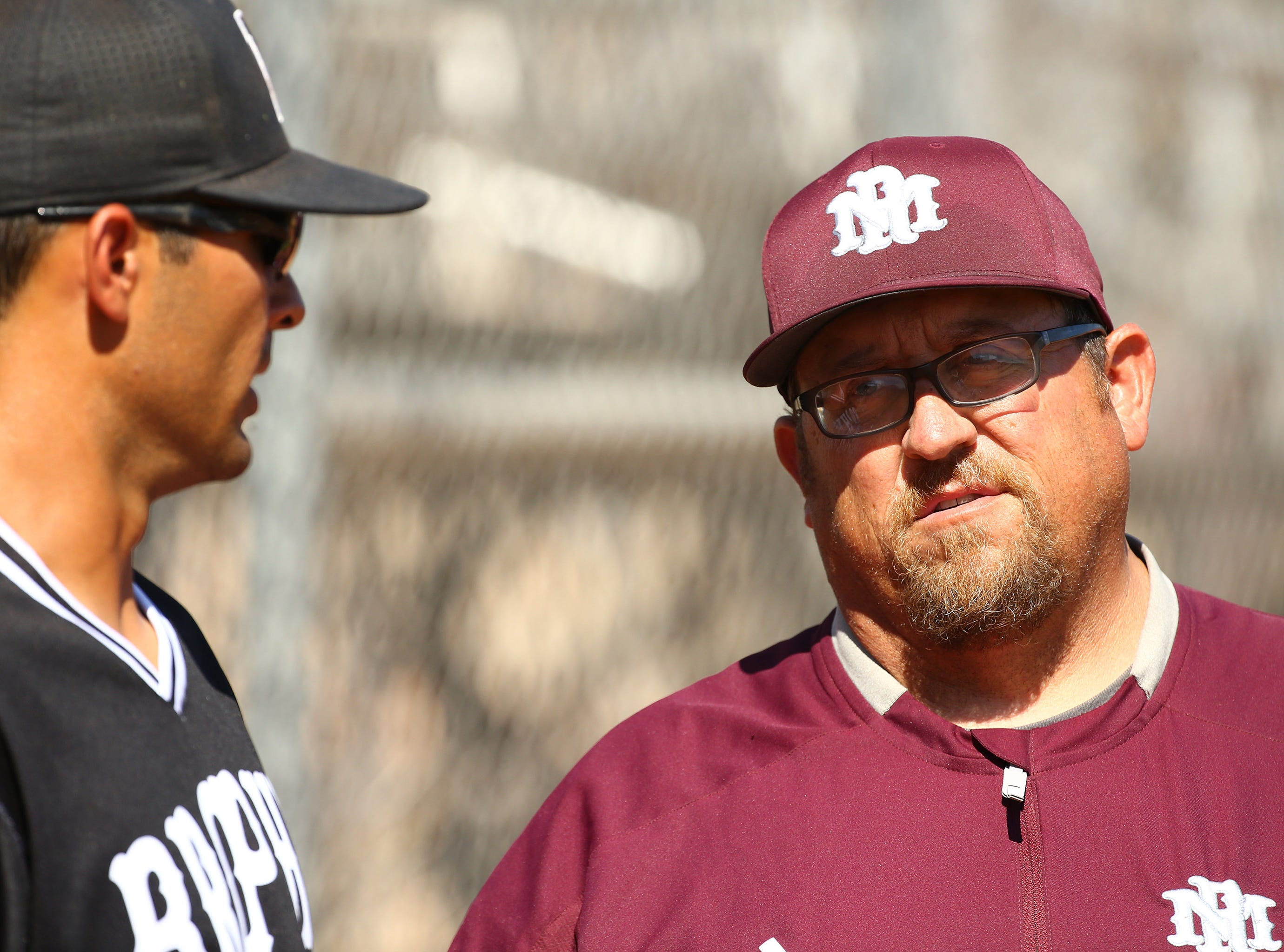 Mountain Ridge coach Artie Cox (right) talks with Brophy Prep coach Josh Garcia on Apr. 24, 2019 in Phoenix, Ariz