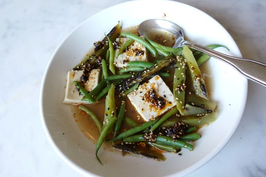 Celtuce with green beans, soft tofu, sesame and ginger broth at FnB in Scottsdale.