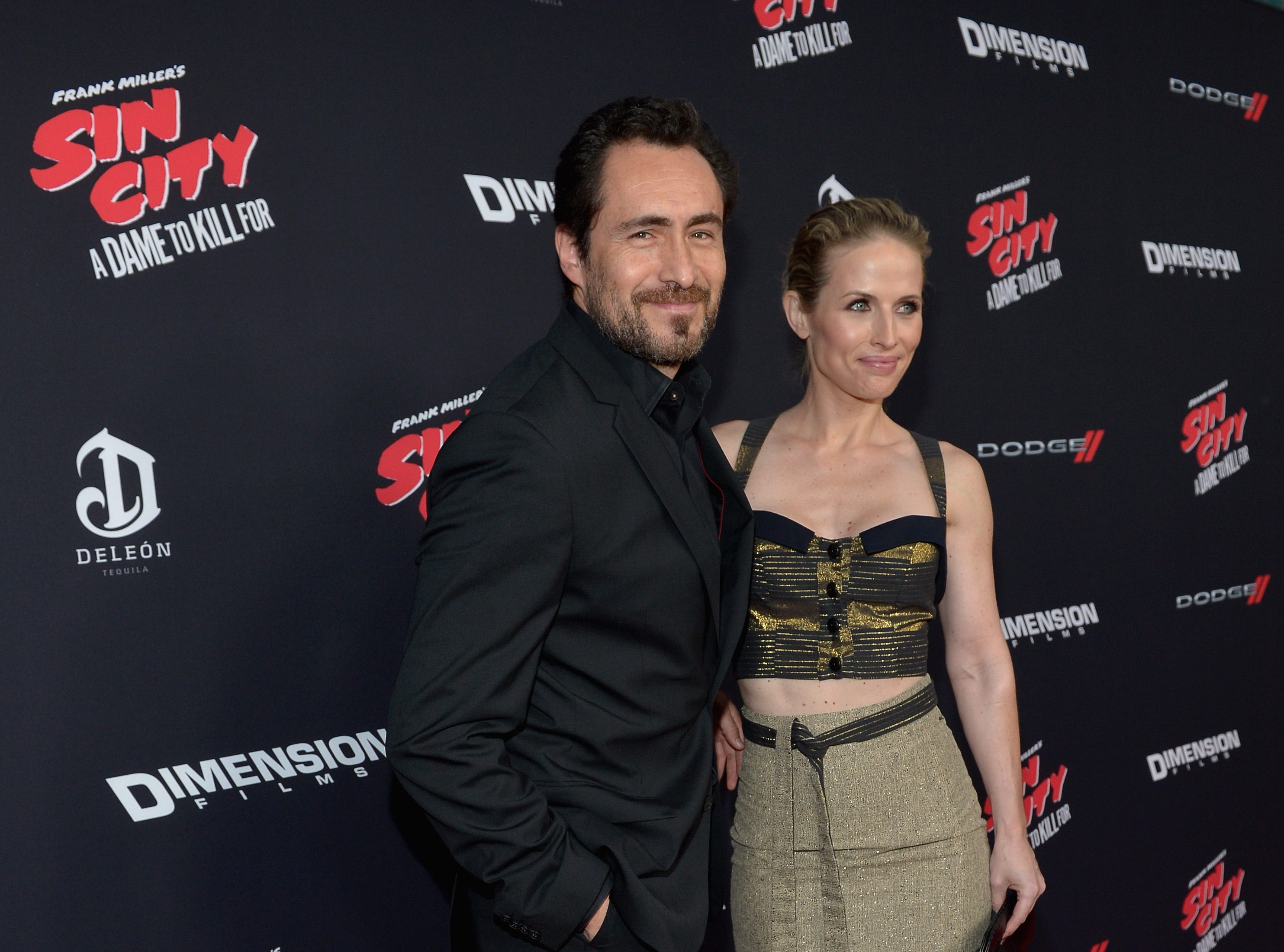 """Demian Bichir and Stefanie Sherk attend the premiere of """"Sin City: A Dame To Kill For"""" on Aug. 19, 2014, in Hollywood, California."""