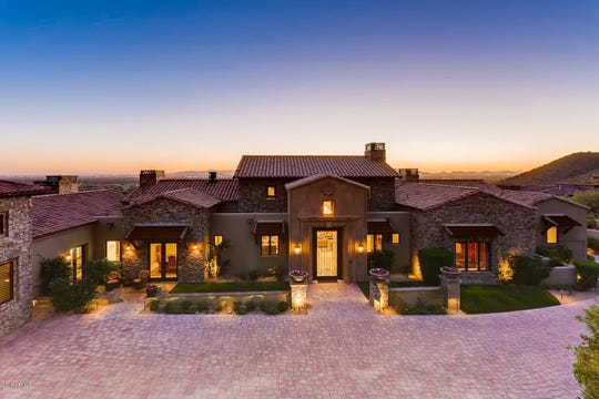 Benjamin Jones and his wife, Alessandra, purchased this mansion in Scottsdale for $4 million that includes a man cave with a golf simulator.