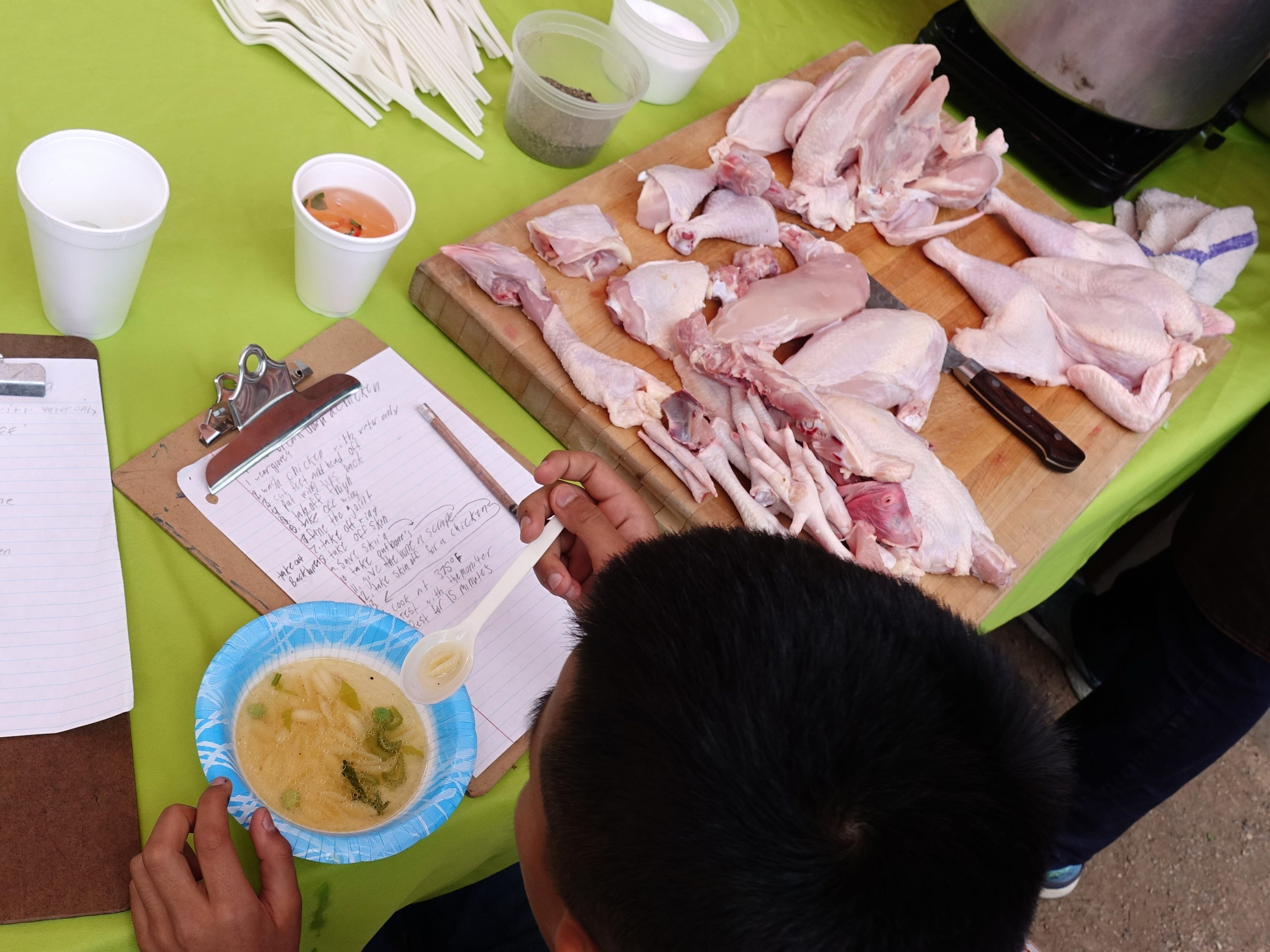 "A student at tastes chicken soup during a ""Chef in the Garden"" lesson at Echo Canyon School in Scottsdale."