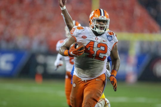 Clemson defensive lineman Christian Wilkins returns a fumble during a game against Pittsburgh during the ACC championship game at Bank of America Stadium.