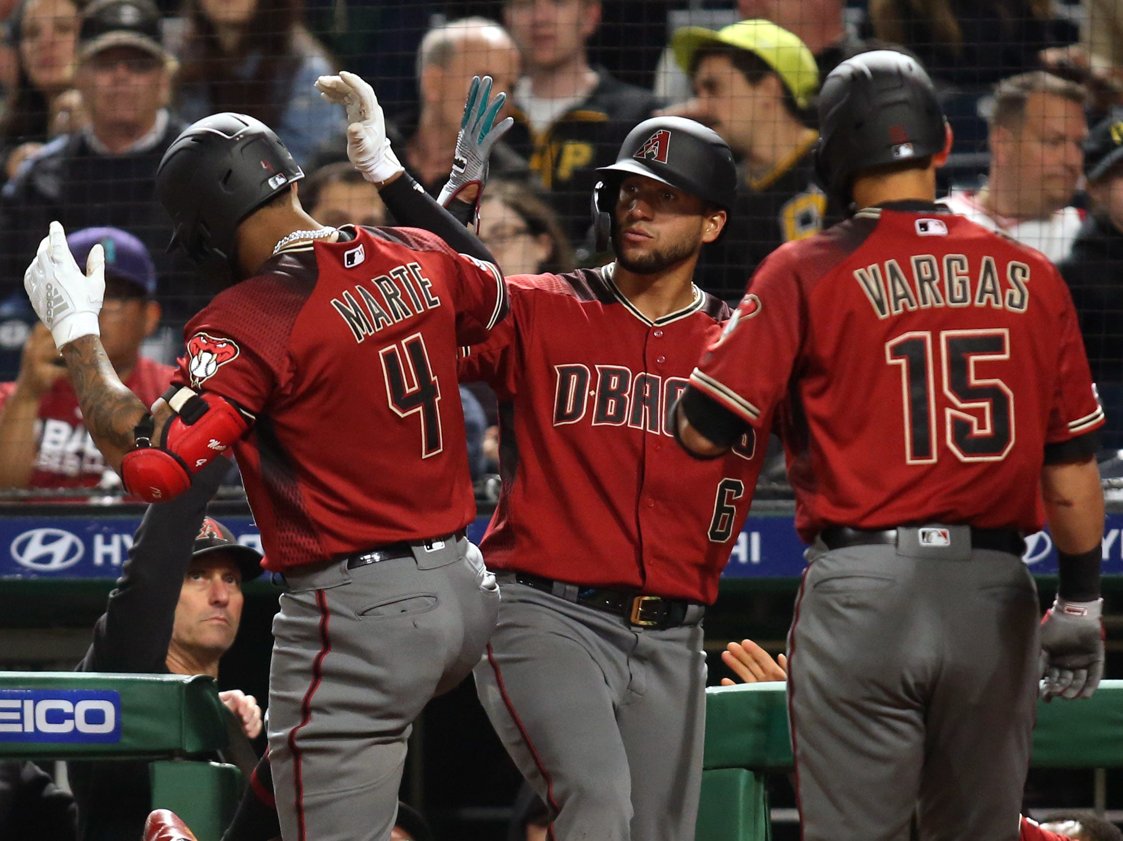 Apr 24, 2019; Pittsburgh, PA, USA;  Arizona Diamondbacks center fielder Ketel Marte (4) celebrates with left fielder David Peralta (6) and third baseman Ildemaro Vargas (15) after hitting a three run home run against the Pittsburgh Pirates during the eighth inning at PNC Park. Mandatory Credit: Charles LeClaire-USA TODAY Sports