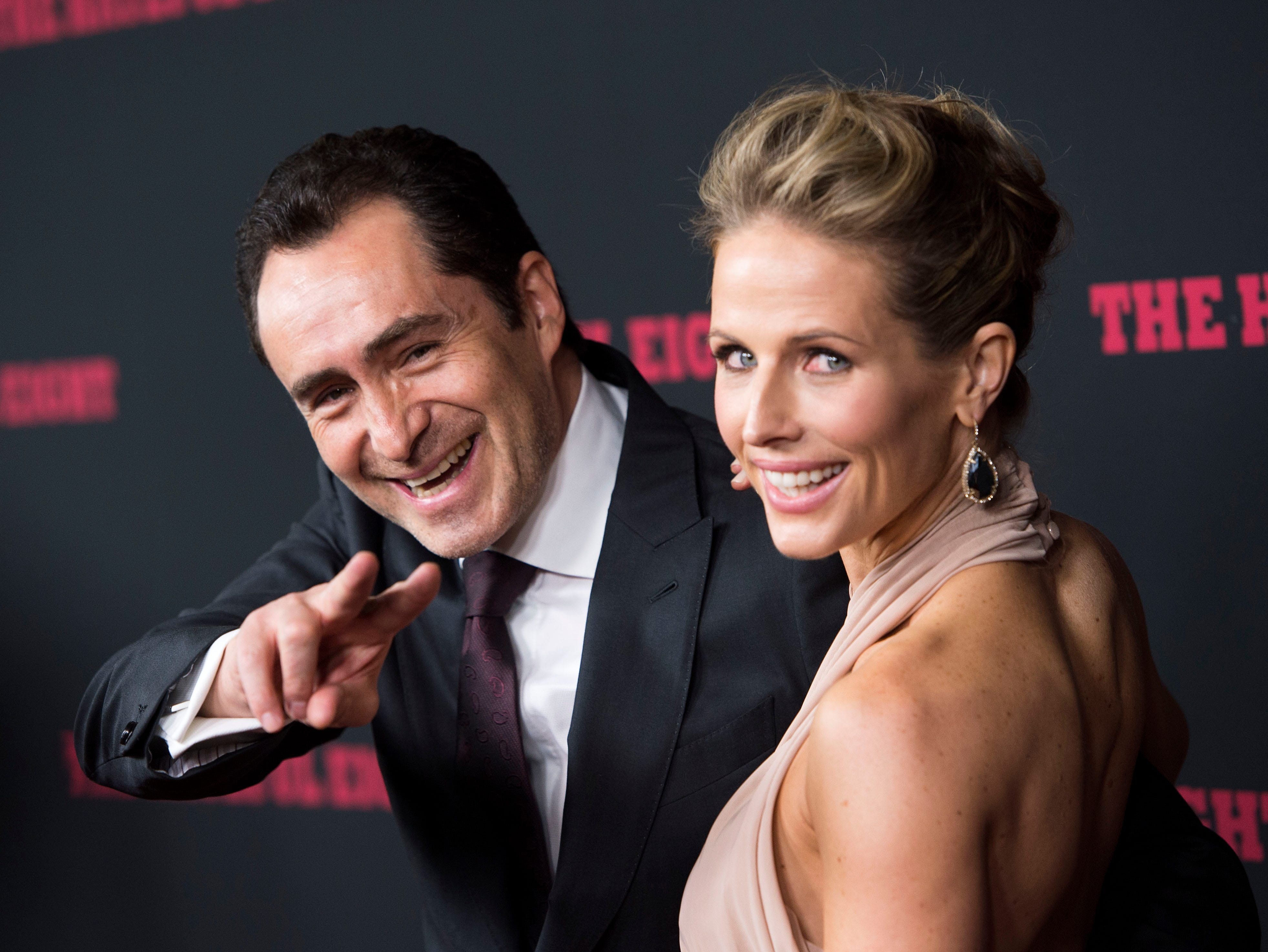 """Demian Bichir and Stefanie Sherk  attend the premiere of his film """"The Hateful Eight"""" on Dec. 7, 2015, in Hollywood, California."""