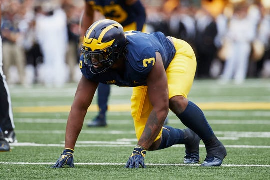 Michigan defensive lineman Rashan Gary gets set on the line of scrimmage during a game against Western Michigan at Michigan Stadium.