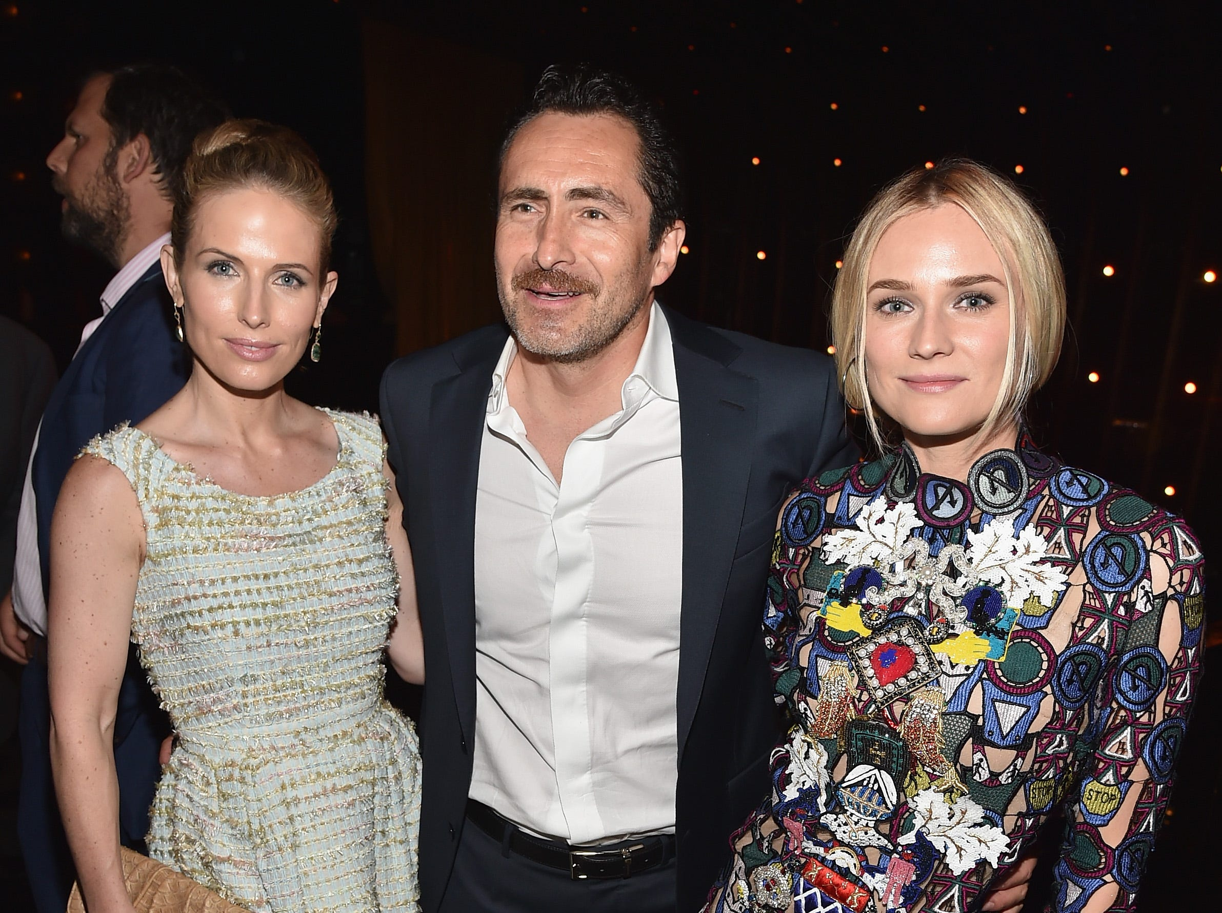 """Demian Bichir is flanked by wife Stefanie Sherk (left) and co-star Diane Kruger at the season premiere party for """"The Bridge"""" on July 7, 2014, in West Hollywood, California."""