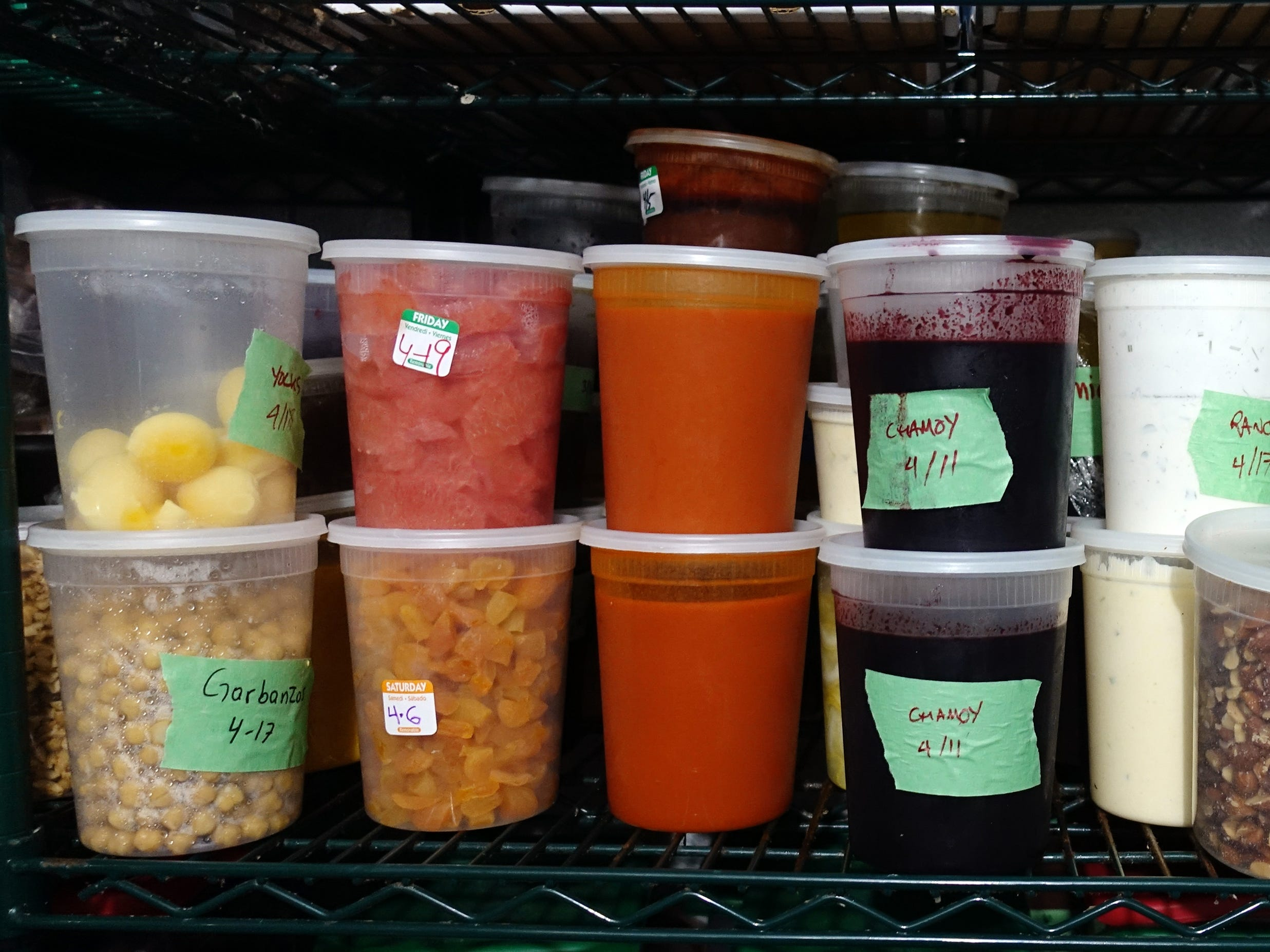 Containers filled with vegetables, pickles and sauces line the shelves of the walk-in at FnB in Scottsdale.