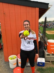 Palmyra's Abbey Krahling shows off the ball she used to become the Cougars' first pitcher to reach 300 career strikeouts in last Thursday's dramatic 3-2 win vs. Mechanicsburg