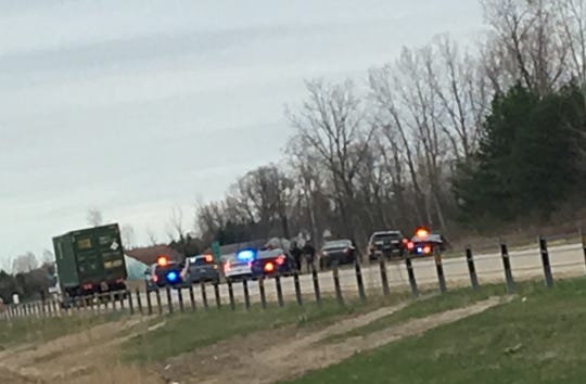 Police vehicles line eastbound I-94 in St. Clair Township following a police chase and crash. The suspect ran from the scene.