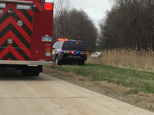 A white vehicle comes to a stop off the side of eastbound I-94 in St. Clair Township following a police chase and crash.