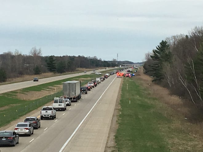Traffic is backed up on I-94 following a police chase and crash. The suspect took off on foot.