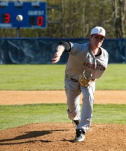 Arlington's Andrew Cubberly throws a pitch during Wednesday's game versus Roy C. Ketcham.