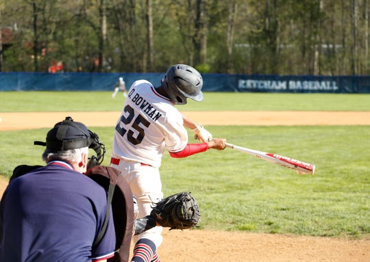 Roy C. Ketcham's Quentin Bowman makes contact during an at-bat against Arlington on Wednesday.