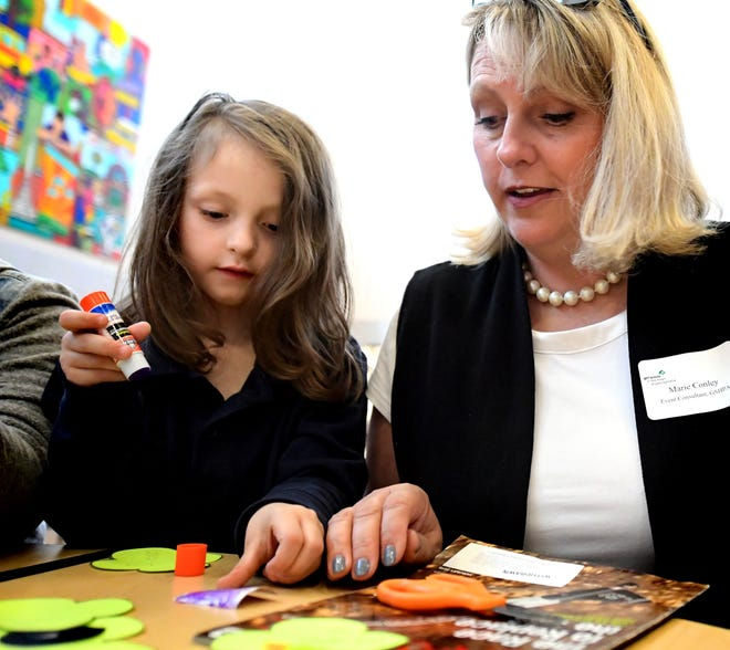 Girls Scout event consultant Marie Conley talks with Ferguson K-8 kindergartner and girl scout Alayna Price as she works during a STEAM after-school program at the school Wednesday, April 24, 2019. Girl Scouts in the Heart of Pennsylvania partnered with Martin LibraryÊto offer York City students access to its STEAM mobile programming through the district's after-school programs. Bill Kalina photo