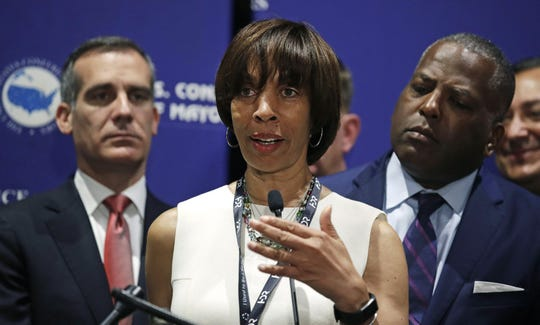 "In this June 8, 2018 file photo, Baltimore Mayor Catherine Pugh addresses a gathering during the annual meeting of the U.S. Conference of Mayors in Boston.When Bernard ""Jack"" Young automatically became Baltimore's acting mayor on April 1, he emphasized that he'd act only as a ""placeholder"" for the embattled elected mayor."