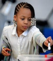 Ferguson K-8 second grader and girl scout Karma Deshields chooses a marker during a STEAM after-school program at the school Wednesday, April 24, 2019. Girl Scouts in the Heart of Pennsylvania partnered with Martin Library to offer York City students access to its STEAM mobile programming through the district's after-school programs. Bill Kalina photo