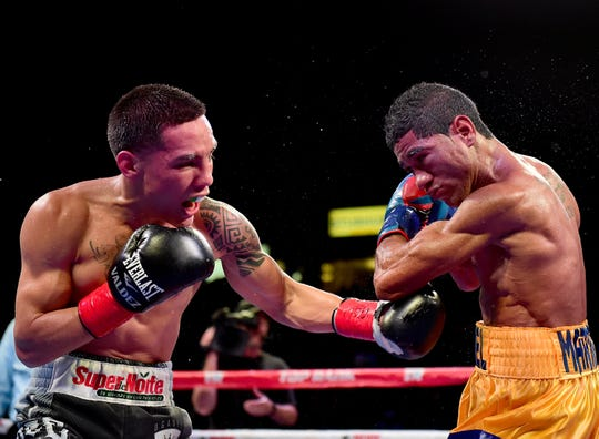 Oscar Valdez of Mexico punches Miguel Marriaga of Colombia on his way to a 12-round unanimous decision during the WBO Featherweight World Championship at StubHub Center on April 22, 2017 in Carson, Calif.