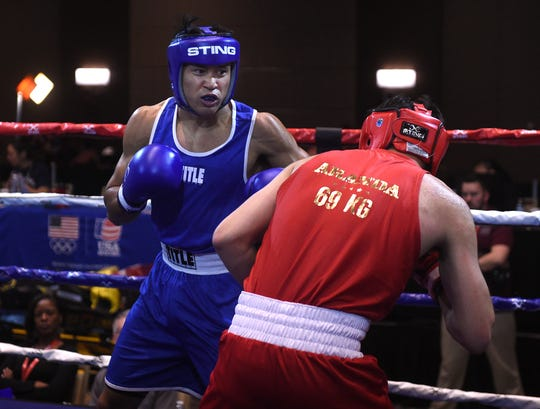Reno's J.J. Mariano, left, takes on Victor Aranda, of El Paso, during the USA Boxing 2019 Western Elite Qualifier and Regional Championships at the Grand Sierra Resort in Reno on March 29, 2019.
