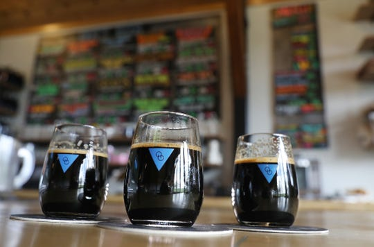 A trio of Imperial Stouts are poured and placed on the bar at the new Other Half Rochester brewery in Bloomfield Thursday, April 25, 2019.  The popular NYC brewery is set to open its Rochester location this weekend, in the former Nedloh Brewing location.