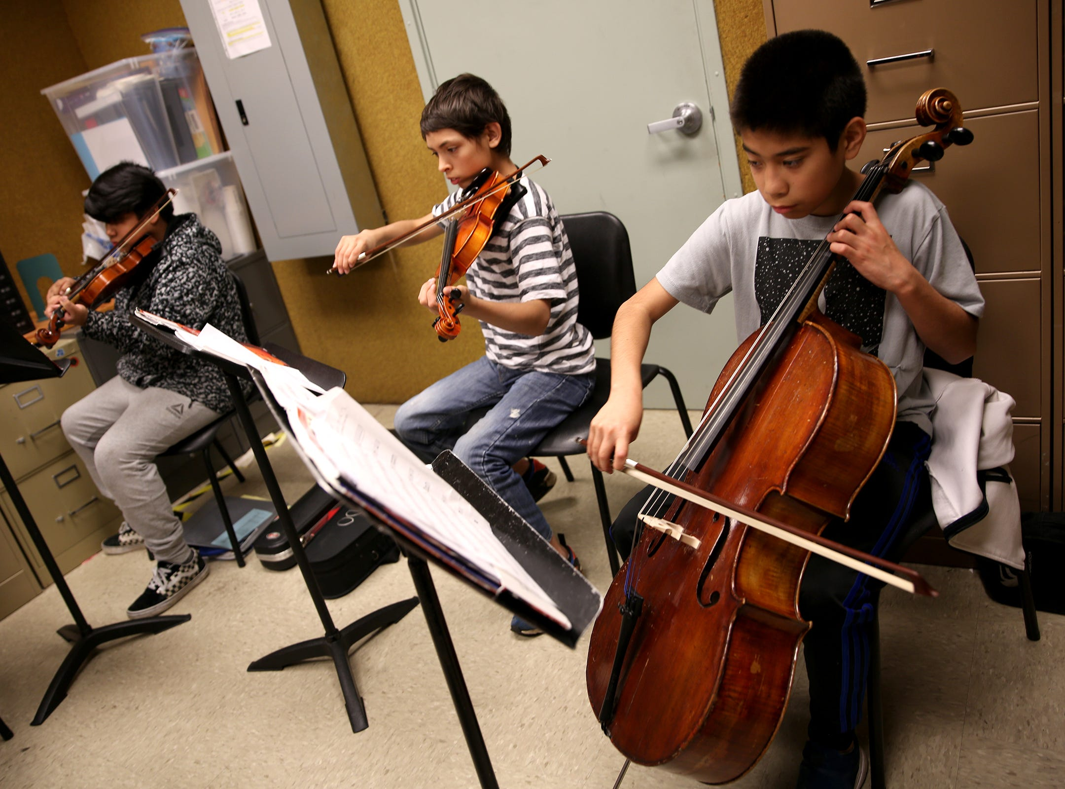 Waldo Middle School students participate in the Music Lessons Project, which offers private or small group lessons to students in Title I schools, in Salem on April 19, 2019.
