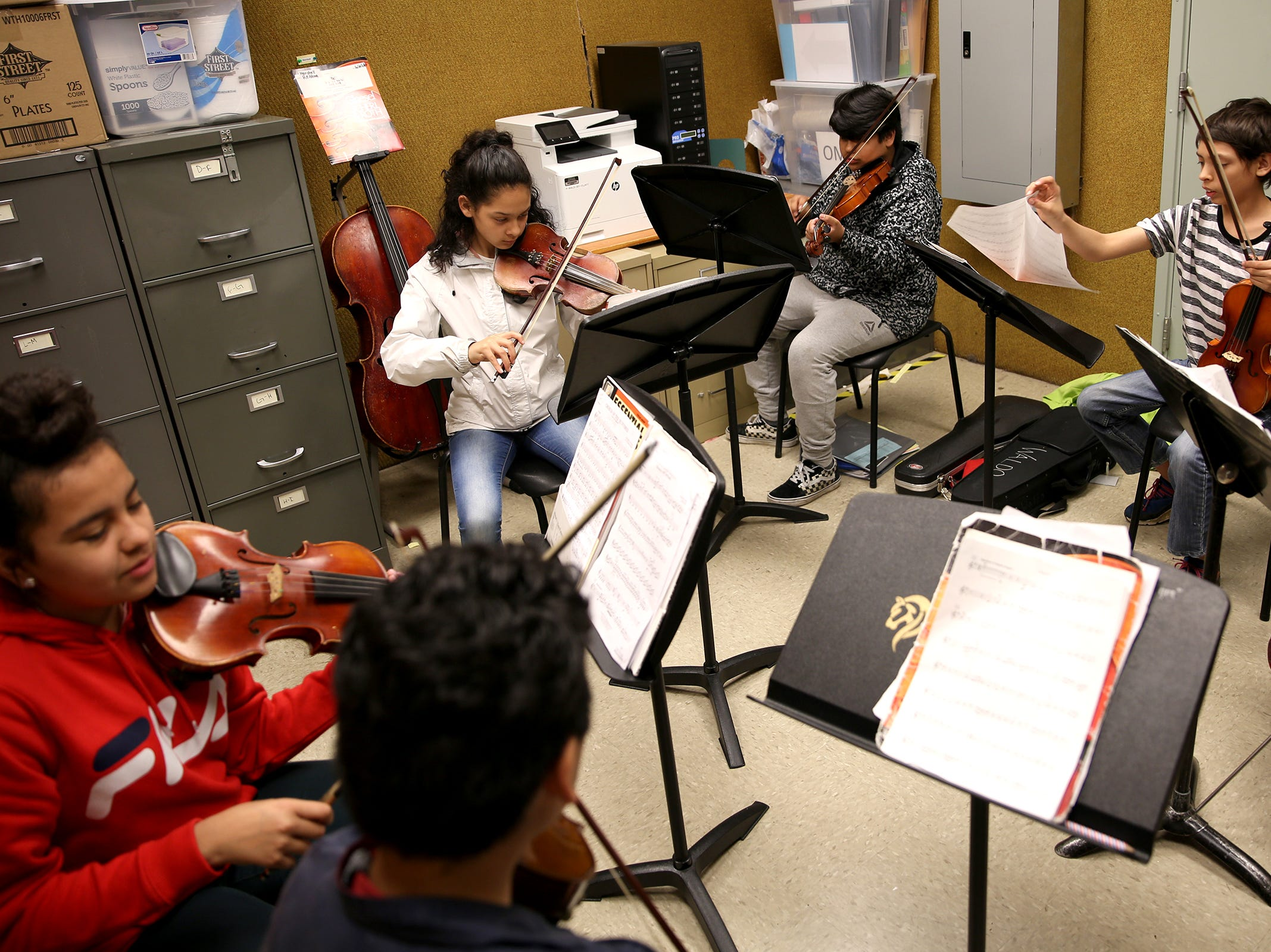 Students participate in the Music Lessons Project, which offers private or small group lessons to students in Title I schools, at Waldo Middle School on April 19, 2019.