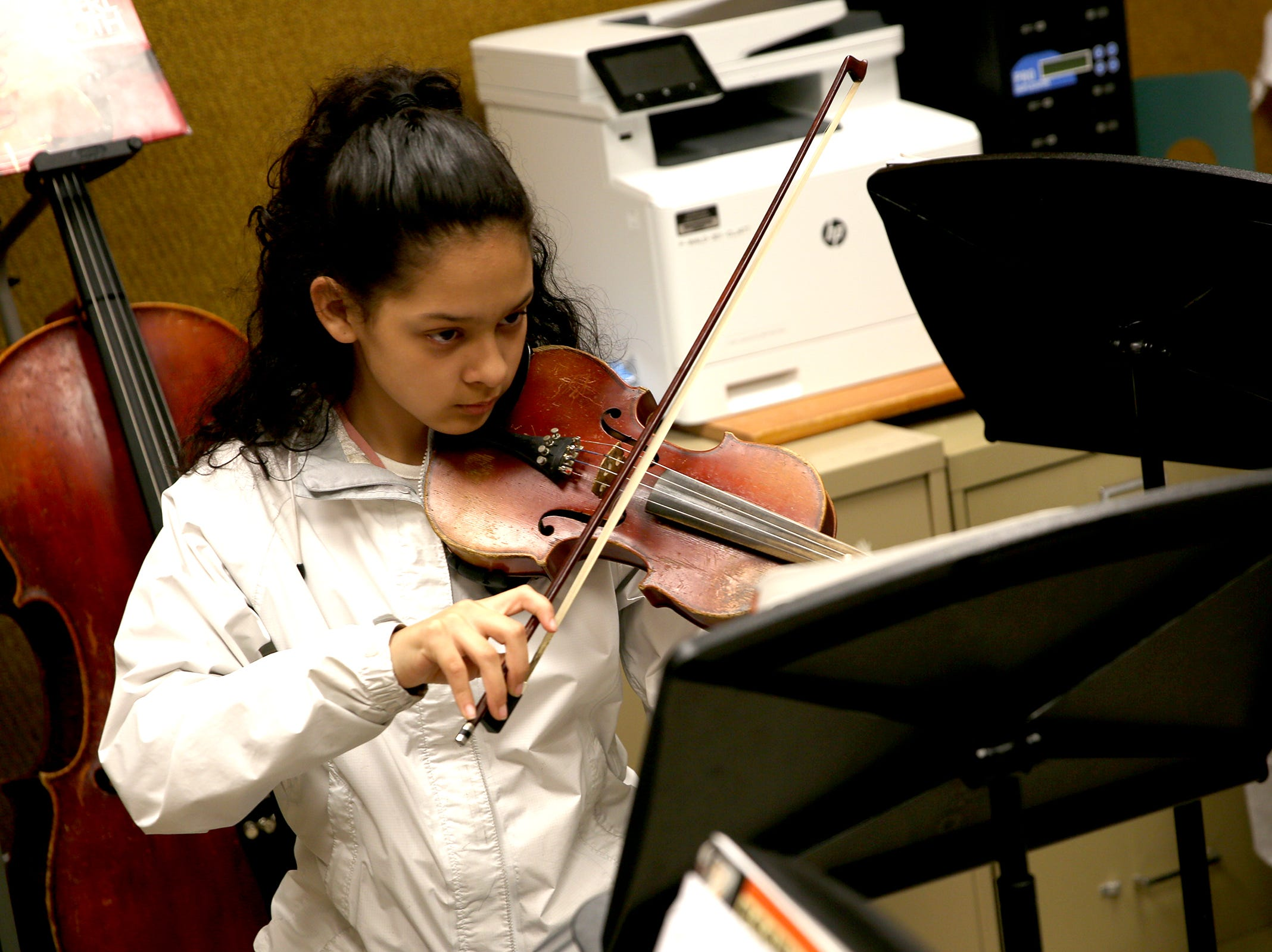 Sixth grade student, Emily Gonzalez, plays the violin during a Music Lessons Project class, which offers private or small group lessons to students in Title I schools, at Waldo Middle School on April 19, 2019.