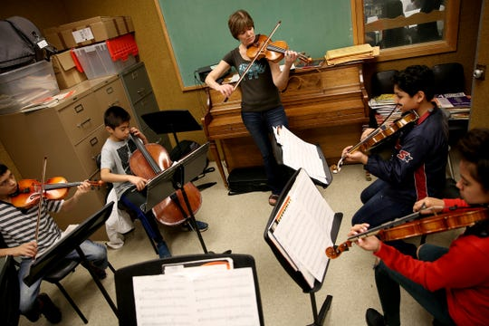 Music teacher, Sigrun Oprea, works with sixth and seventh grade students through the Music Lessons Project at Waldo Middle School on April 19, 2019. The project offers private or small group lessons to students in Title I schools.
