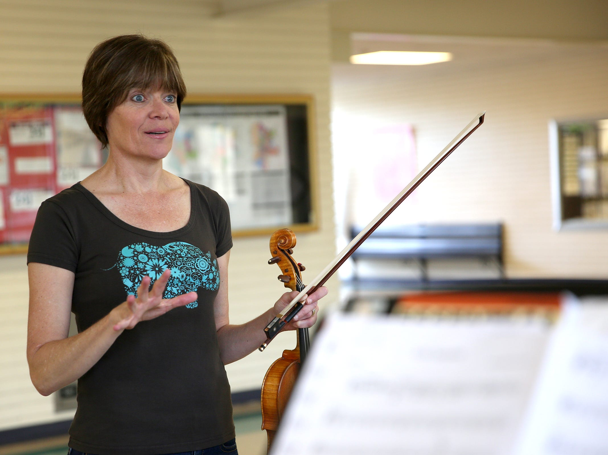 Music teacher, Sigrun Oprea, instructs students during practice at Waldo Middle School on April 19, 2019.