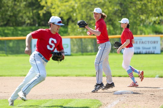 South Salem High School baseball player Ryan Brown (center) practices at Gilmore Field in Salem on April 24, 2019.