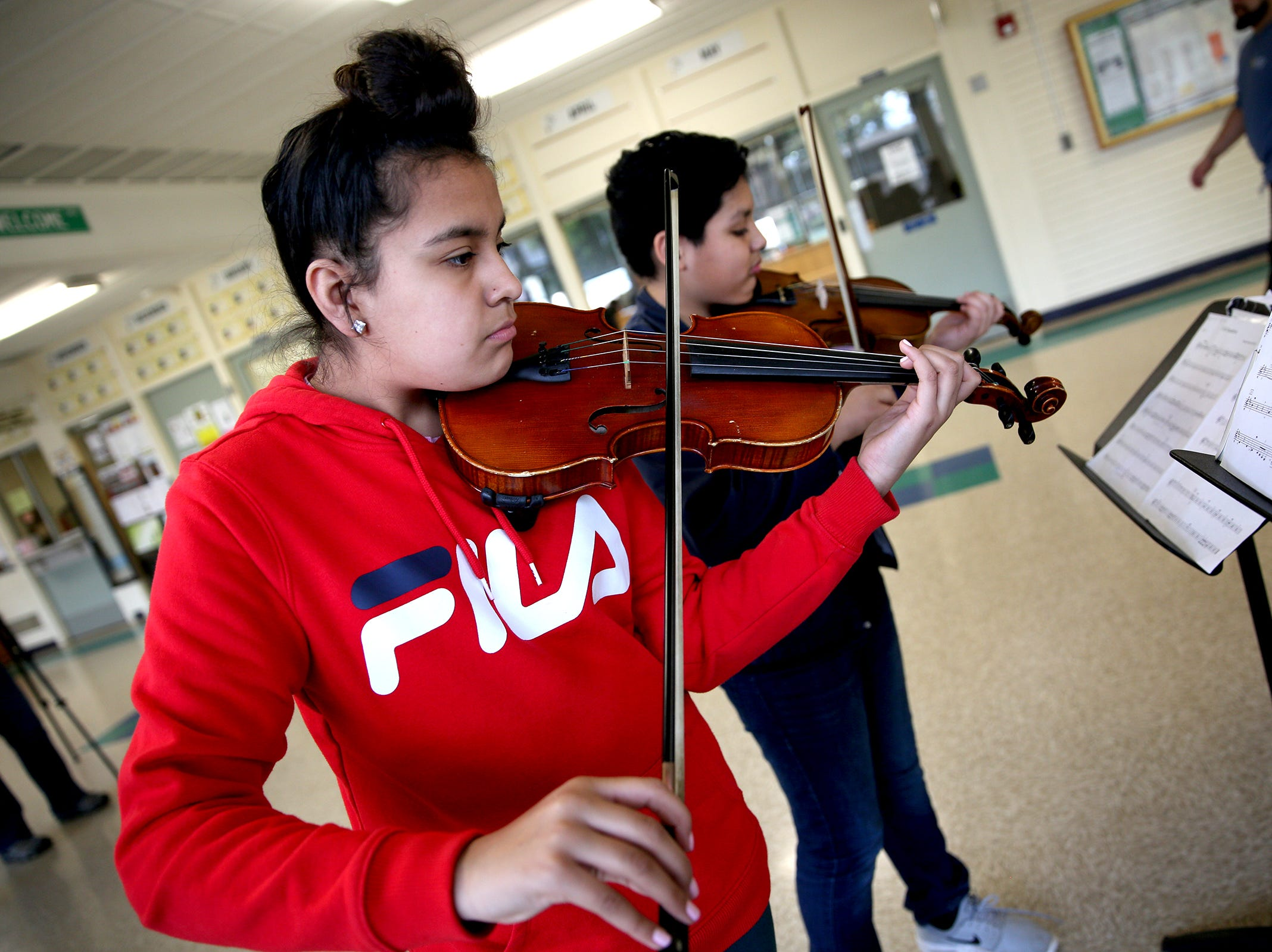 Sixth grade student, Nadia Luna, plays her instrument during a Music Lessons Project class, which offers private or small group lessons to students in Title I schools, at Waldo Middle School on April 19, 2019.