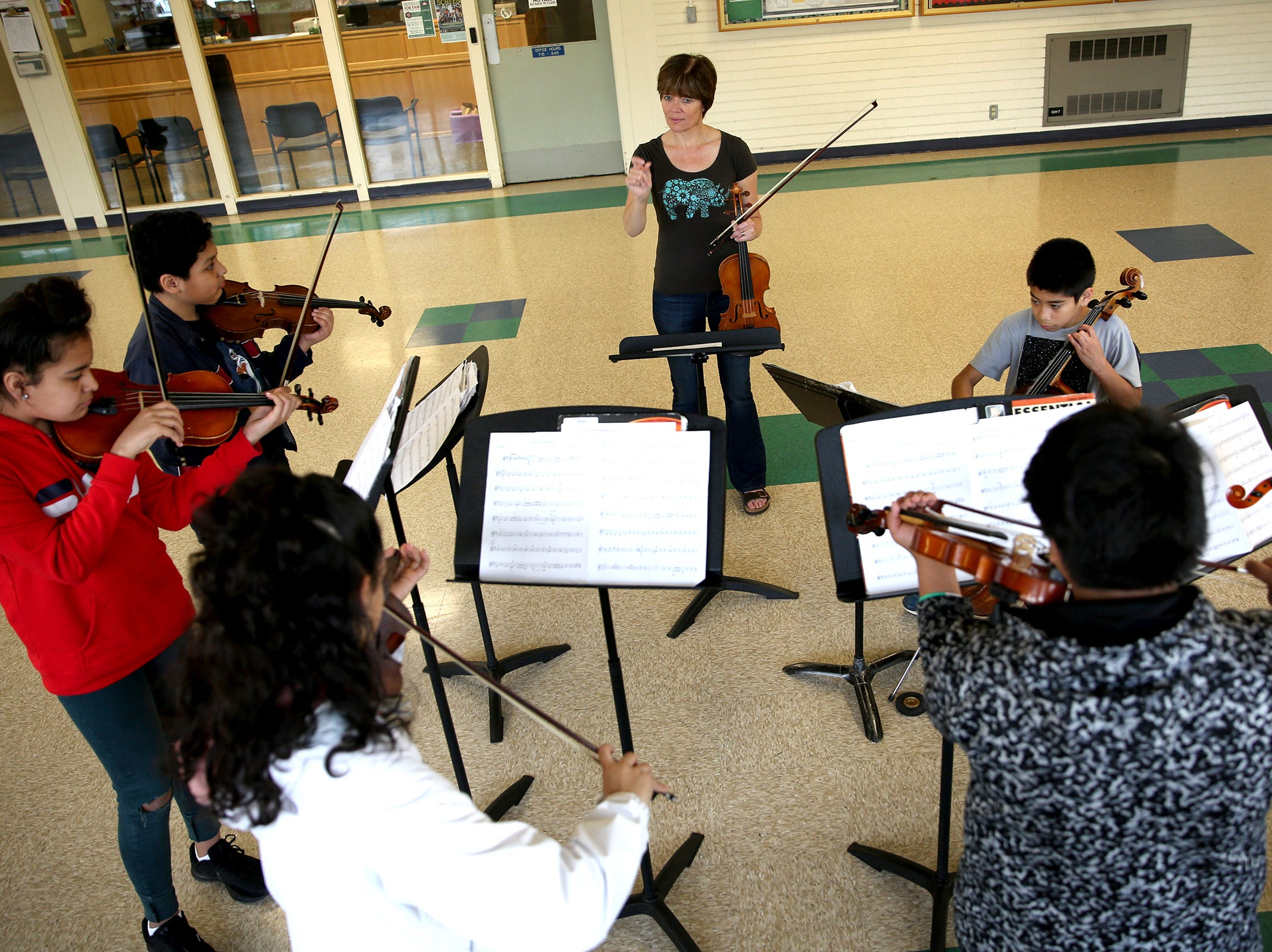 Music teacher, Sigrun Oprea, works with six sixth students through the Music Lessons Project, which offers private or small group lessons to students in Title I schools, at Waldo Middle School on April 19, 2019.