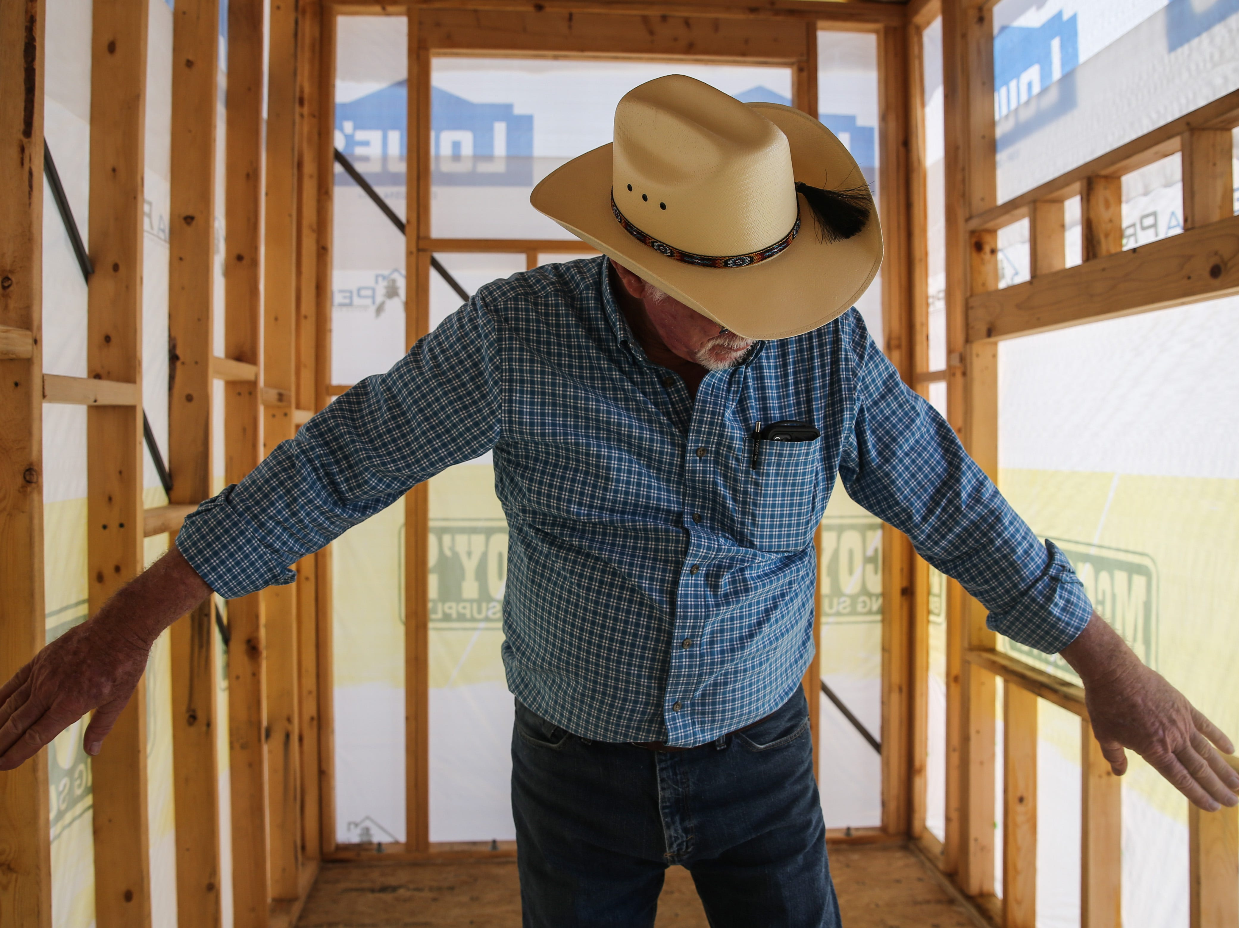 Instructor Nelson Davis points out where walls will be built inside a tiny house Thursday, April 25, 2019, at Howard College.