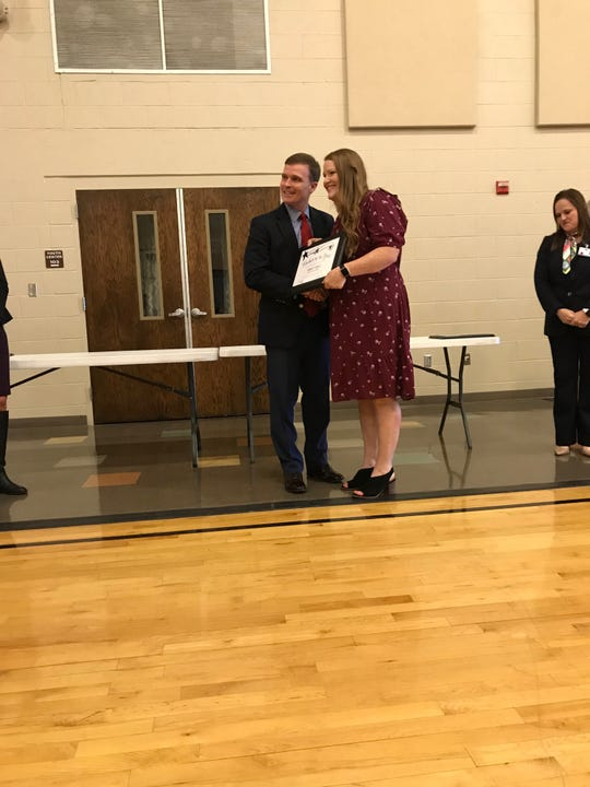 Ashley Gould accepts the 2019 Lake View High School teacher of the year award from San Angelo Independent School District superintendent Carl Dethloff.