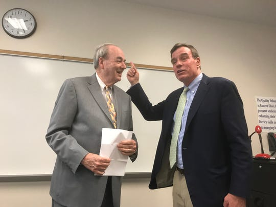 Billy Greer, Eastern Shore Community College president, left, greets Sen. Mark Warner during a town hall meeting at the college in Melfa, Virginia on Wednesday, April 24, 2019.