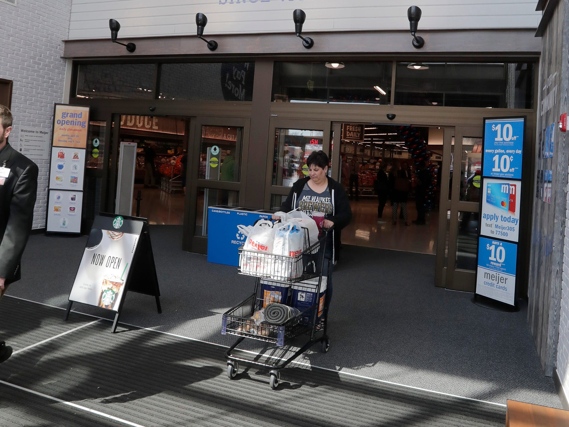 Customers exit the entrance at Meijer, Thursday April 25, 2019, in Sheboygan, Wis. The 155,000-square-foot supercenter has 300 employees on opening day.