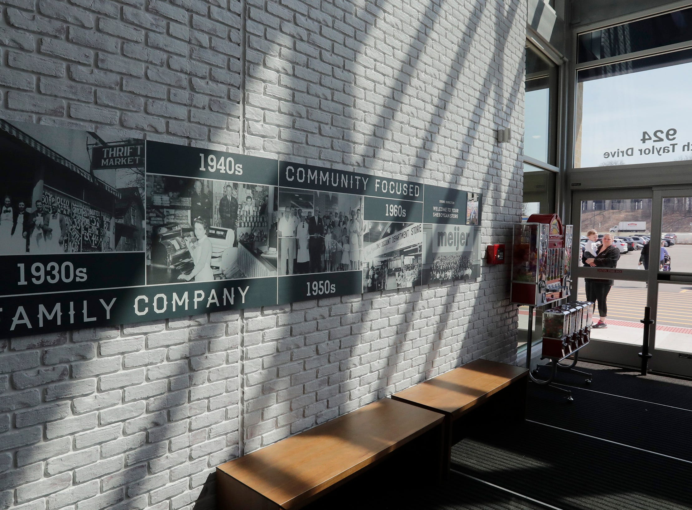 The entrance features historical photos at Meijer, Thursday April 25, 2019, in Sheboygan, Wis. The 155,000-square-foot supercenter has 300 employees on opening day.
