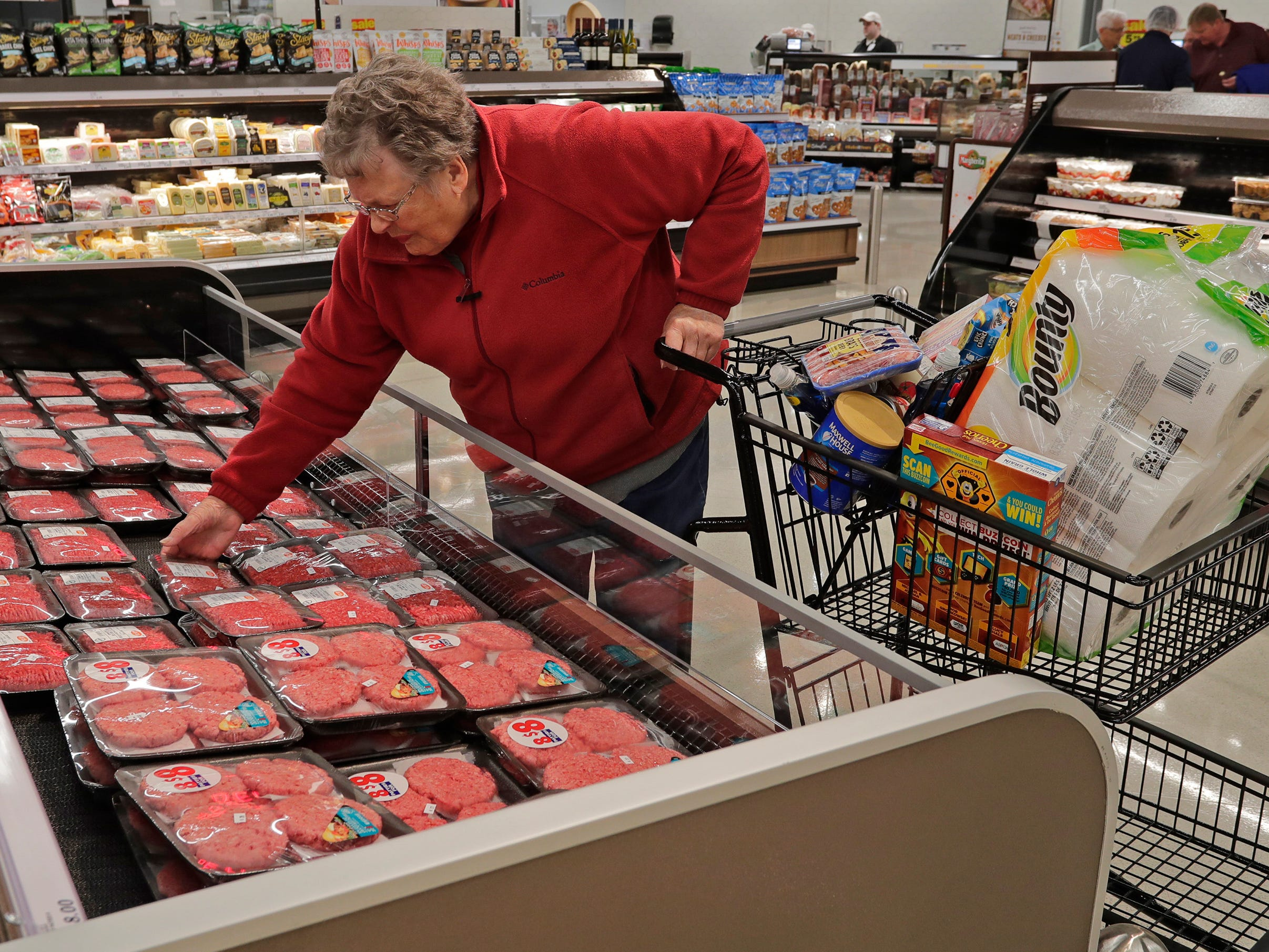 Lorraine Broetzmann of Sheboygan Falls, Wis. purchases food items during opening day at Meijer, Thursday April 25, 2019, in Sheboygan, Wis. The 155,000-square-foot supercenter has 300 employees on opening day.
