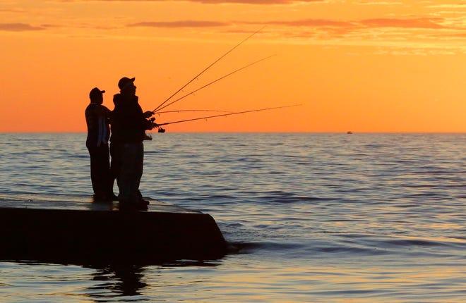 Land fishermen fish off the north pier Wednesday June 7, 2017 in Sheboygan, Wis.
