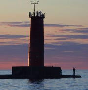 Land fishermen fish off the north pier Wednesday June 7, 2017 in Sheboygan, Wis.