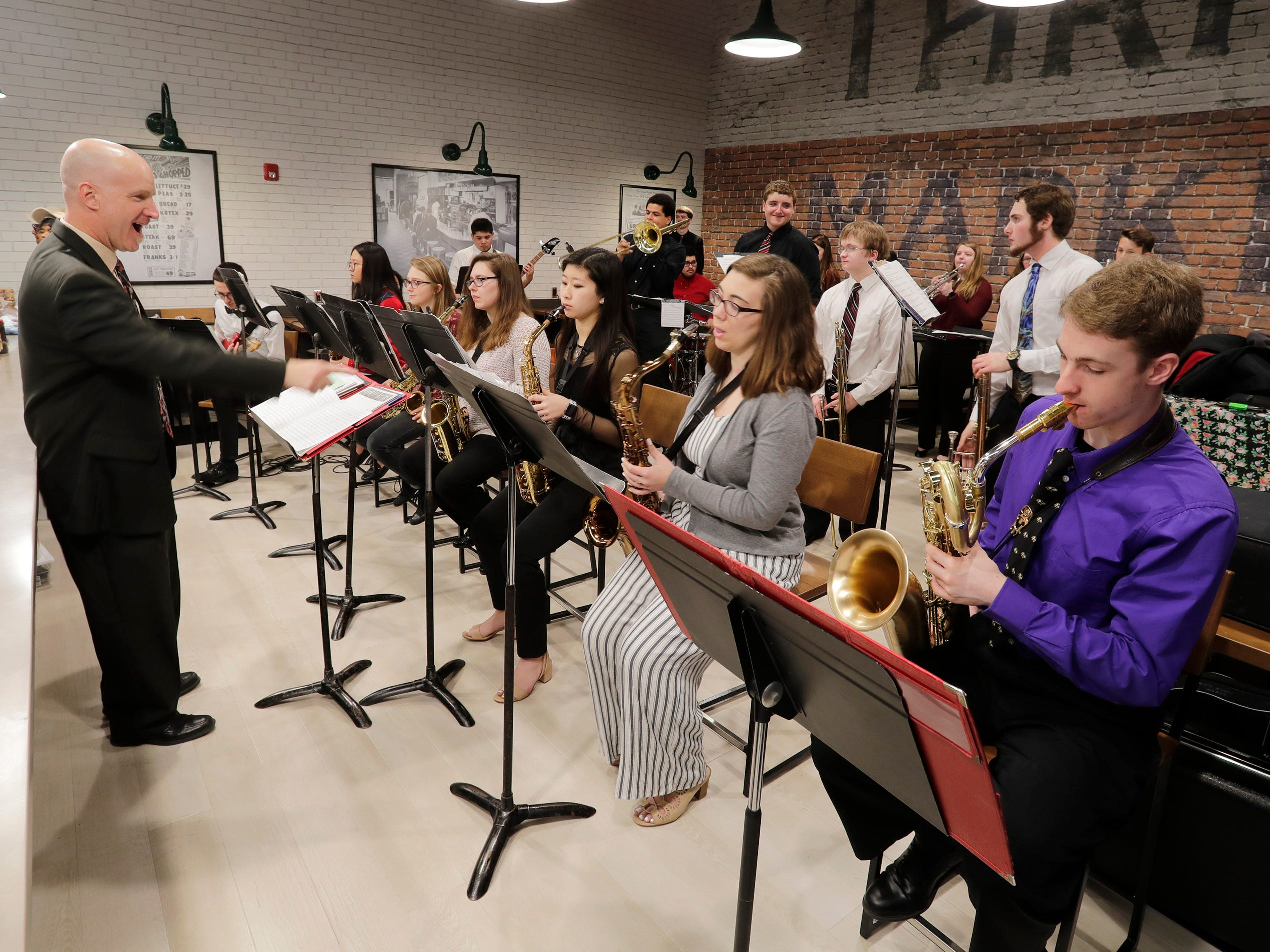 The Sheboygan South jazz band performs under the baton of Wade Heinen during the Grand Opening at Meijer, Thursday April 25, 2019, in Sheboygan, Wis. The 155,000-square-foot supercenter has 300 employees on hand for opening day.