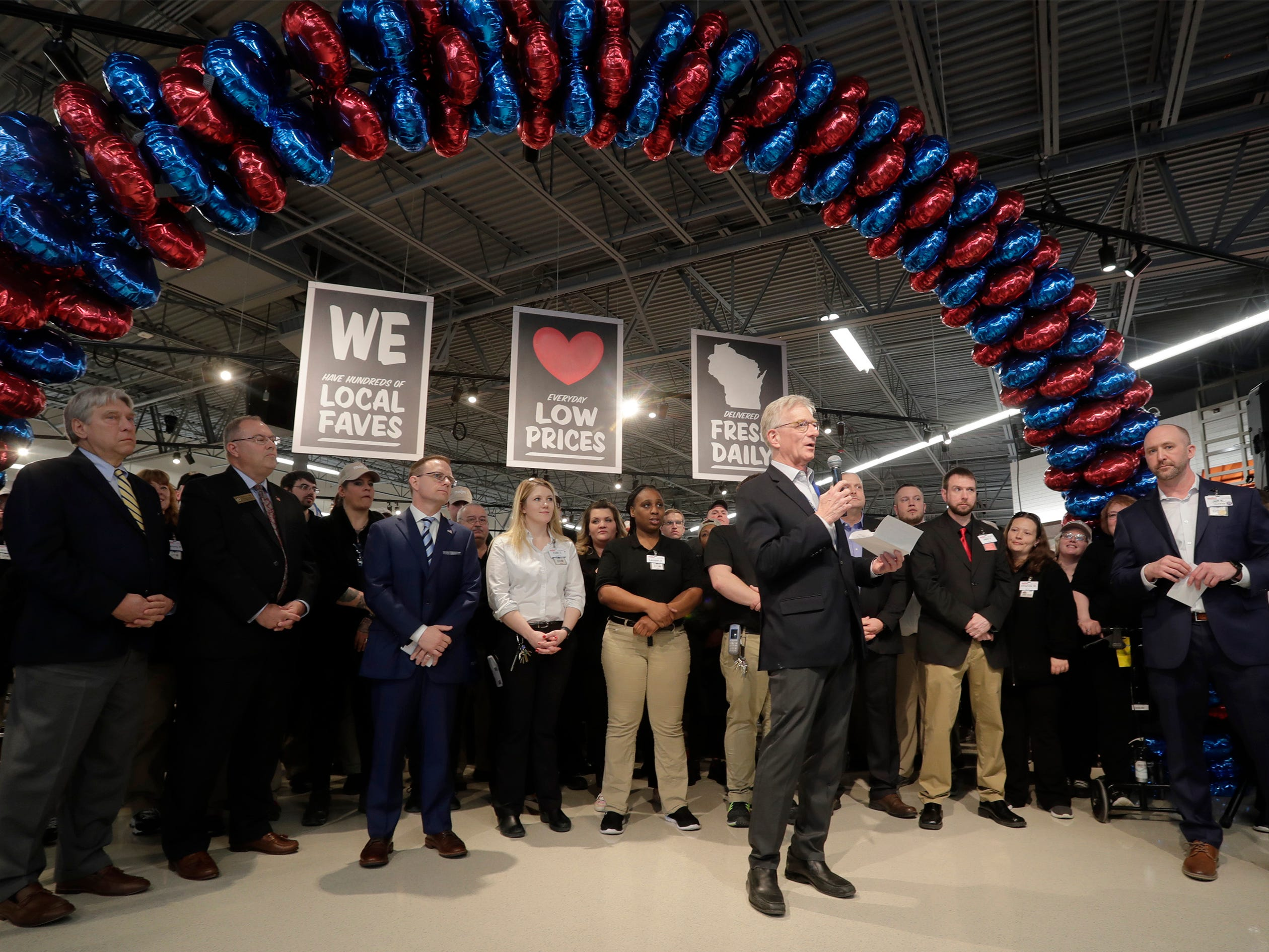 Executive Chairman Hank Meijer, center, speaks at the ribbon cutting at Meijer, Thursday April 25, 2019, in Sheboygan, Wis. The 155,000-square-foot supercenter has 300 employees on opening day.