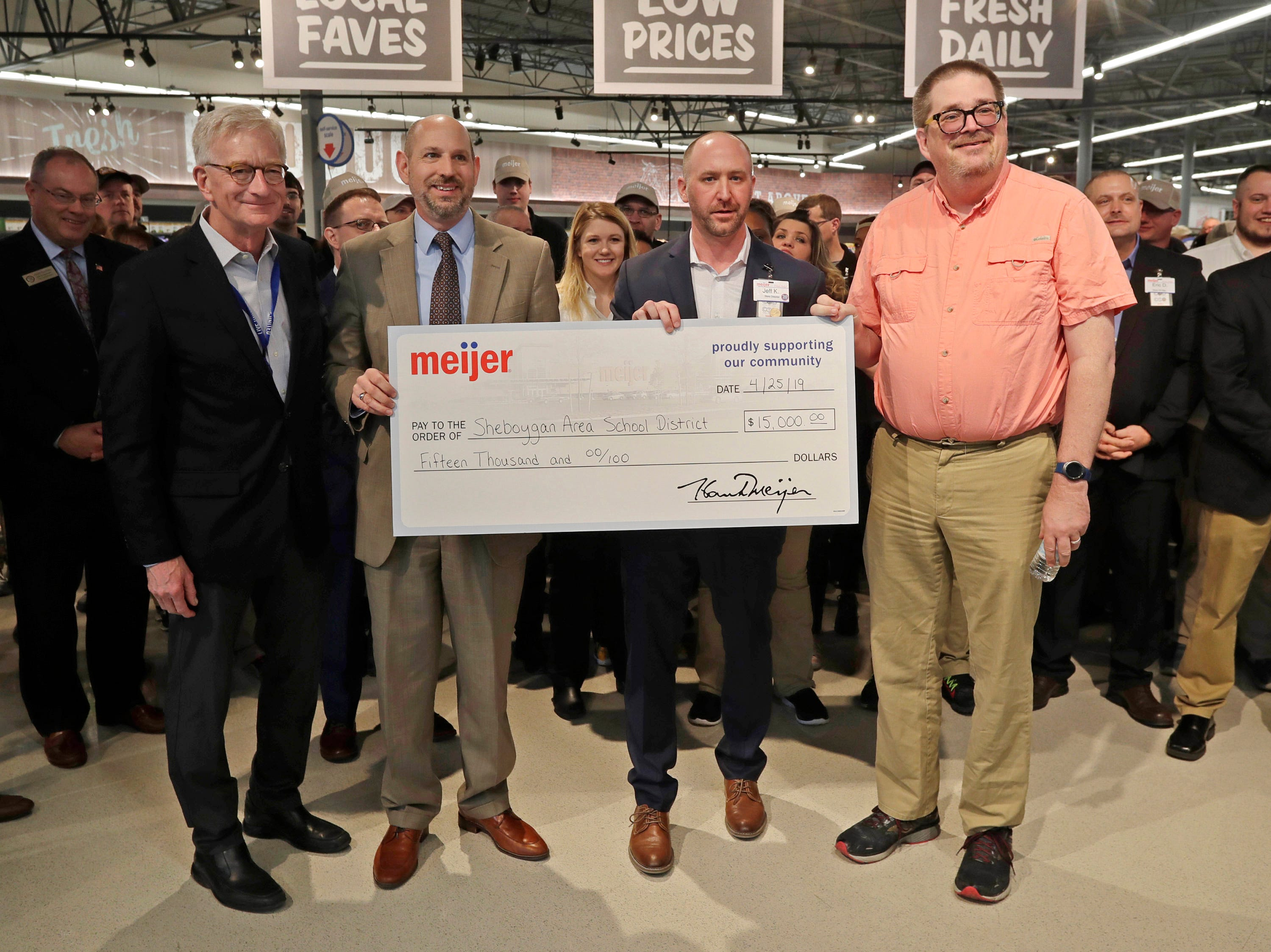 Meijer Executive Chairman Hank Meijer, left, and Sheboygan Store Director Jeff Kietzman, second from left, present a check for $15,000 to the Sheboygan Area School District officials at Meijer, Thursday April 25, 2019, in Sheboygan, Wis. The 155,000-square-foot supercenter has 300 employees on opening day.