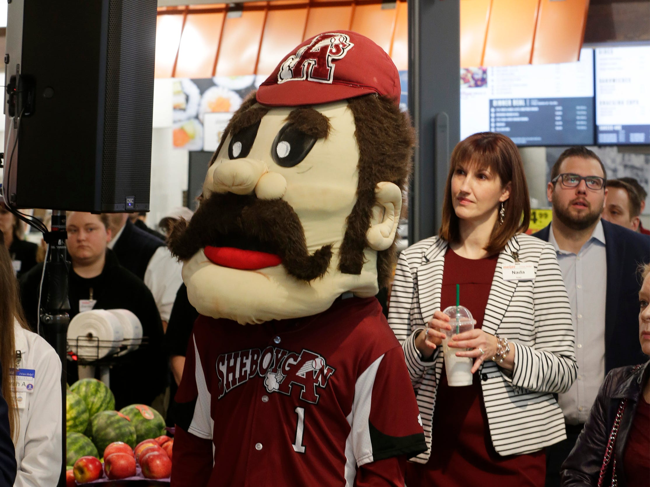 Sheboygan A's No. 1 listens to speeches during the grand opening at Meijer, Thursday April 25, 2019, in Sheboygan, Wis. The 155,000-square-foot supercenter has 300 employees on opening day.