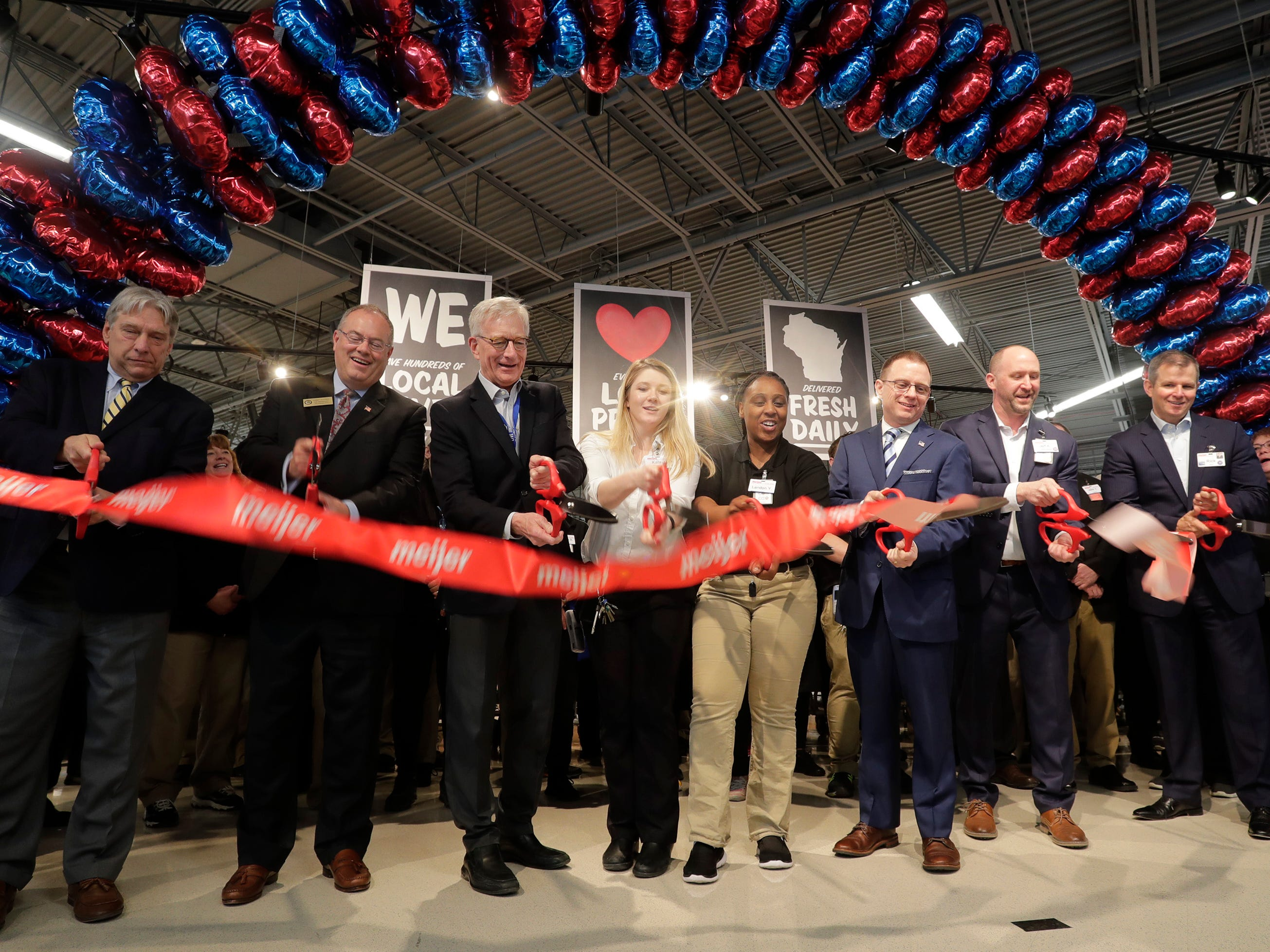 The ribbon is cut, opening the new Meijer Supercenter, Thursday April 25, 2019, in Sheboygan, Wis. The 155,000-square-foot supercenter has 300 employees on opening day. From Left: Brandon Scholz, Wisconsin Grocers Assn; State Rep. Terry Katsma; Hank Meijer, executive chairman of Meijer; Kate Joy, service team leader; Landon Young, cashier; Todd Wolf, Sheboygan common council president; Jeff Kietzman, store director; and Rick Keys.
