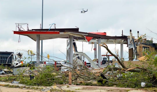 A Louisiana State Police helicopter surveys areas in Ruston that were damaged by a Tornado early Thursday morning.