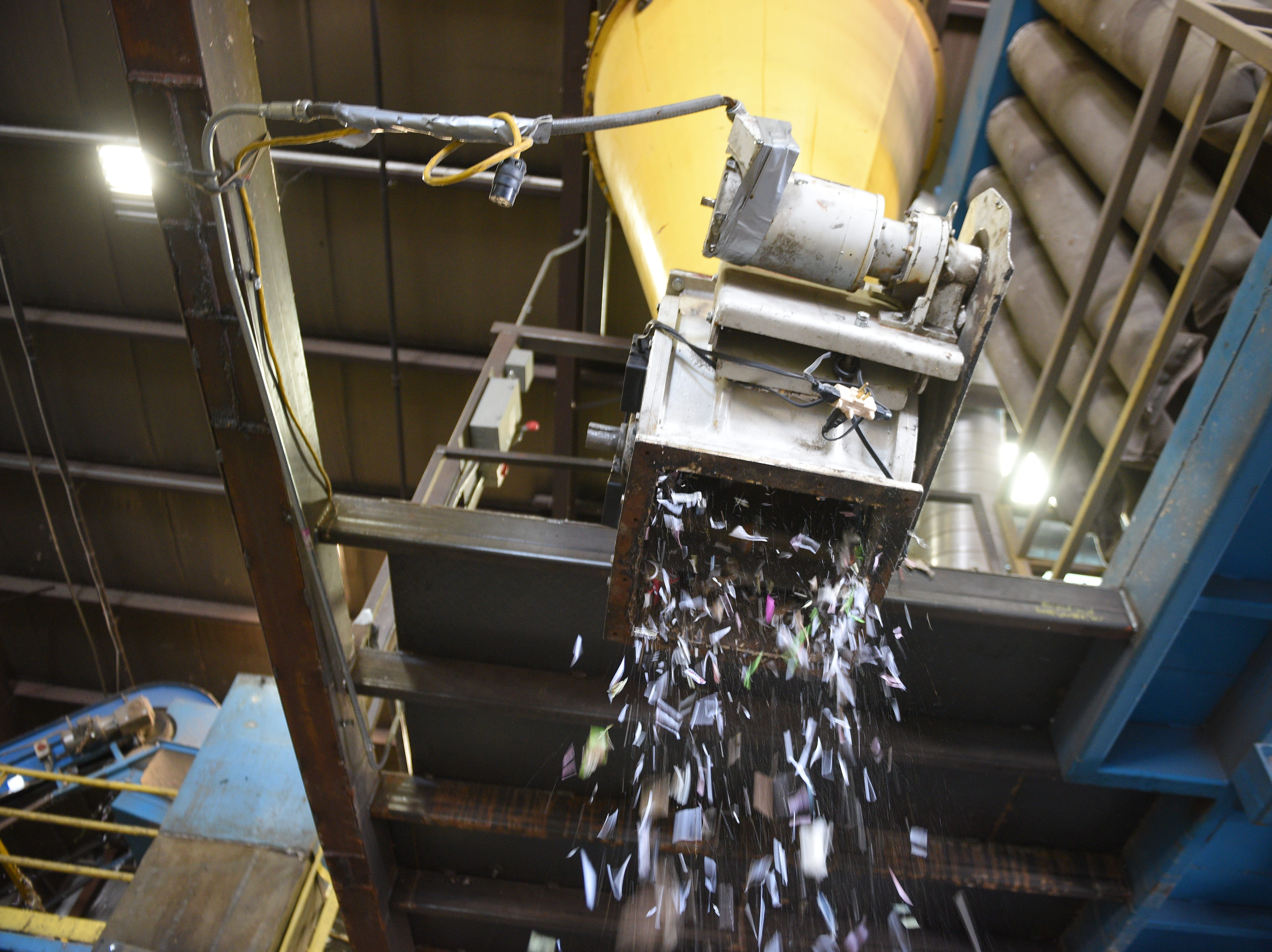 A network of machines and belts work to sort recycled materia at Millennium Recycling in Sioux Falls. Millennium is celebrating its 20th anniversary this year.