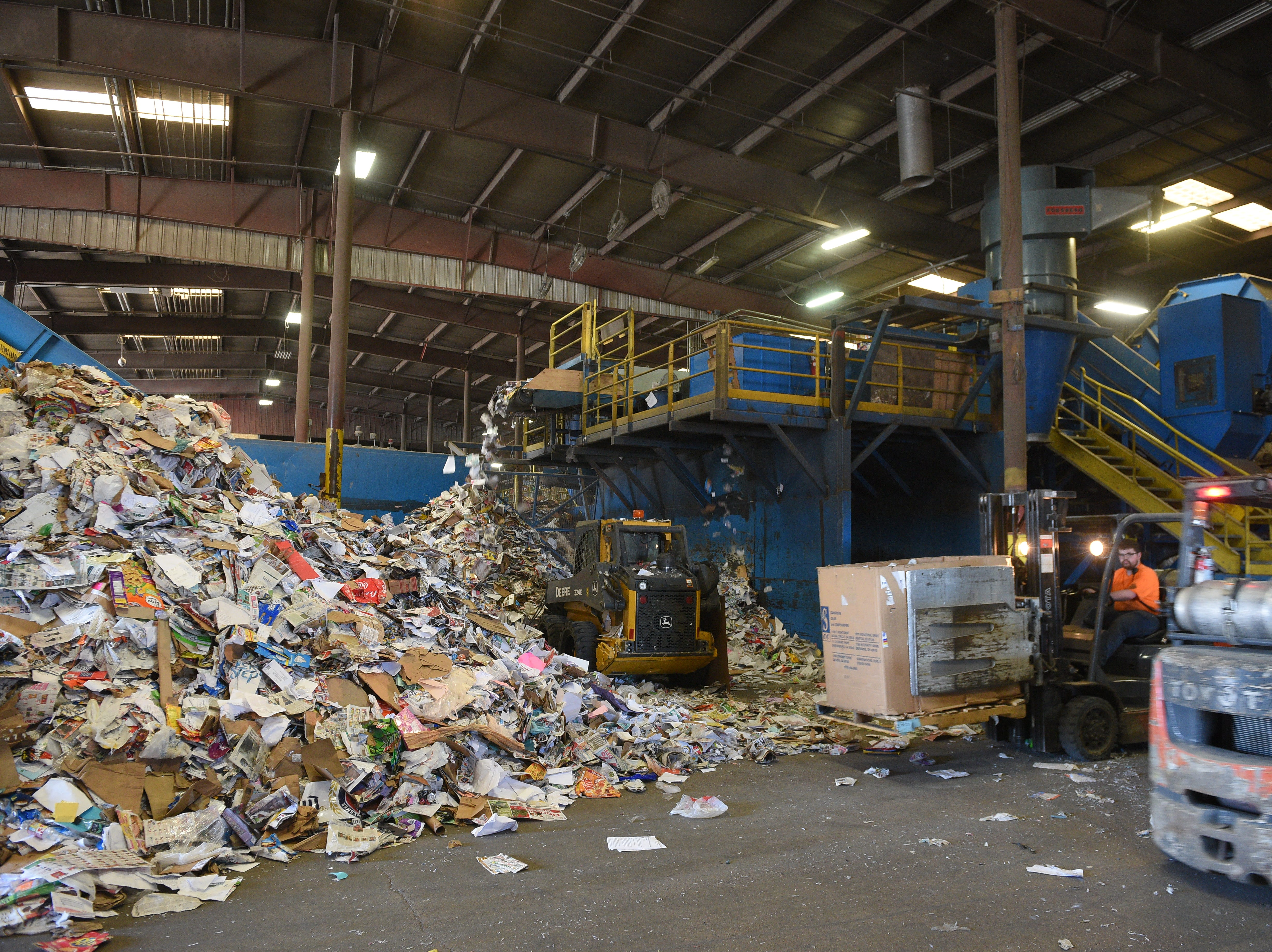 Recycleable materials rest in a pile after going through Millennium Recycling's single-stream sorter.