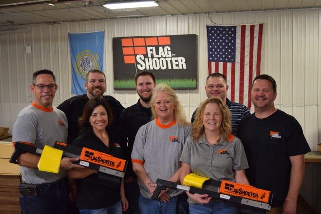 Flagshooter, based just east of Baltic, has eight employees. Front row (L-R): Anita Carrette, Tracy Hagemeyer, Darcie Kringen. Back Row (L-R): Paul Carrette, Joe Winstead, Reed Muehler, Allen Meeks, Robert Bishop.